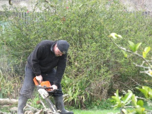 Daddy busy with his chain saw