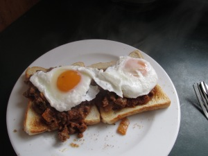 Mince on toast with a poached egg on top.  Unfortunatley, for some reason daddy did not share his breakfast with the two betest maremmas in all the land.